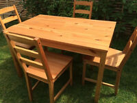 Solid wood dining table with 4 solid wood chairs by Ikea, vgc