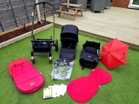 Bugaboo Cameleon pushchair with accessories in black/red