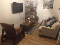 Industrial Furniture, leather seat, coffee table, shelving unit, sofa, rug, light
