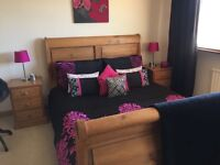 King size sleigh pine bed, bed side cupboards & chest of draws