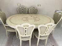 Italian style dining table with 6 chairs.