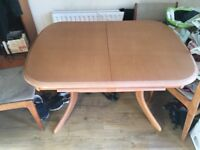 Very good condition dining room wooden table .
