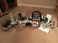 Xbox 360 console + Official Wireless Racing Wheel + 32 games and accessories