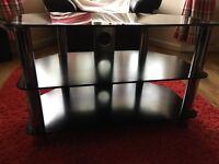 Large black tv stand with glass top