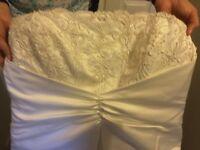 Designer wedding dress by berketex .