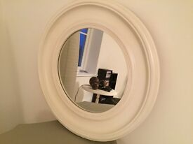 White wooden circular mirror