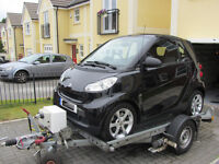 smart fortwo convertible with a smart trailer ideal for towing behind your motorhome