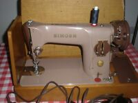 VINTAGE ELECTRIC SINGER SEWING MACHINE FOR SALE.