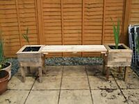 two wooden planters with bench see pictures £20 i deliver locally