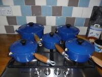 set [5] of Blue Le Creuset Saucepans