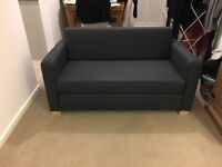 Immaculate condition 2 seater sofa bed.
