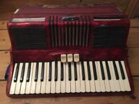 Scandalli 120 bass piano accordion. Colour: red. Condition: used