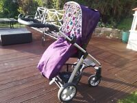 Sola pram/pushchair in plum includes carrycot footmuff and sun parasol and 2 rain covers