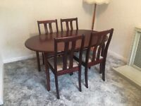 Extendable wooden dining table and chairs x4 for sale