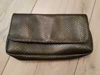 Snakeskin clutch bag