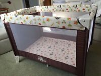 Travel cot with mattress topper and sheets