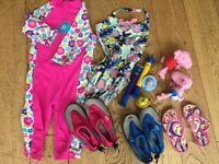 INDIVIDUALLY PRICED £2-£6. Girls swimsuit, UV sun suit, boys beach shoes, flip flops, zoggs swim toy