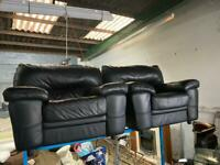 PAIR OF BLACK LEATHER ARMCHAIRS IN EXCELLENT CONDITION