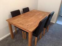 Solid oak extendable dining table with chairs