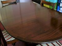5ft to 7ft 1980's dark wood extending dining room table and 4 matching chairs.