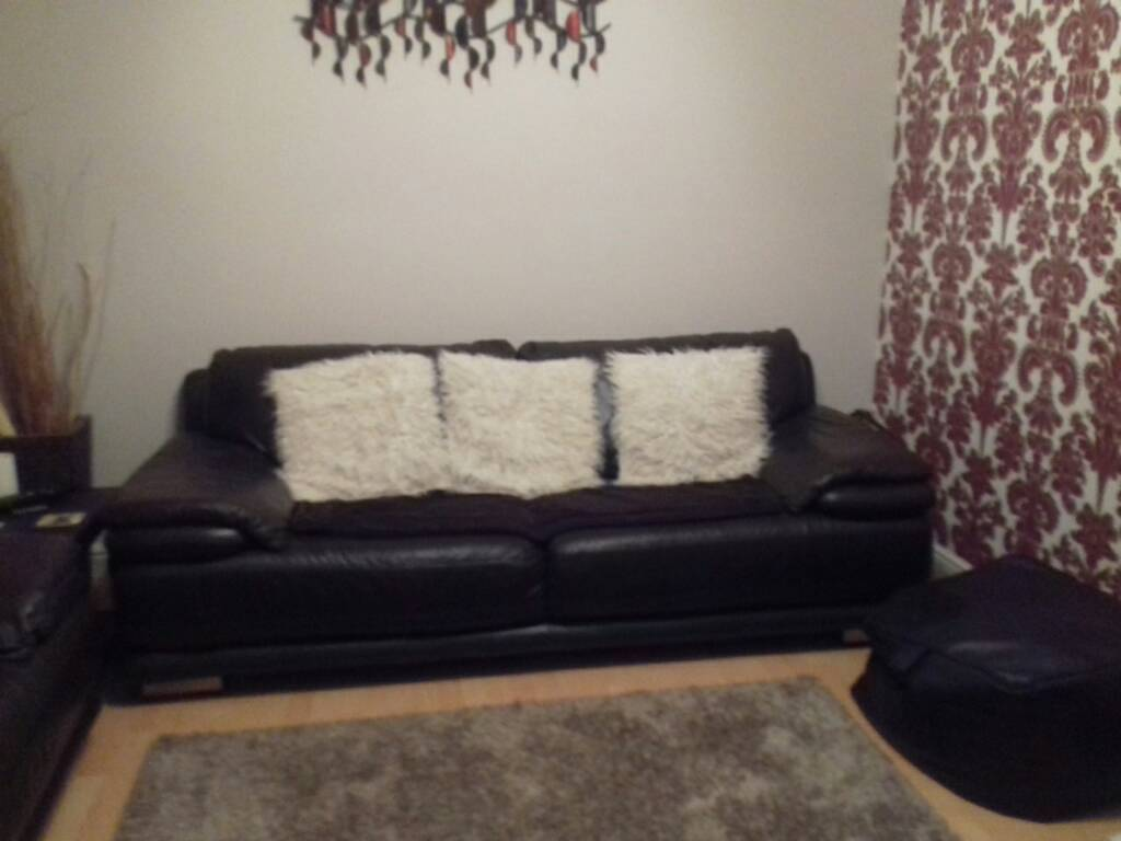 Brown leather sofa and cuddle chair