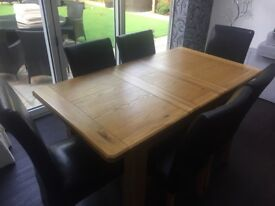 Solid oak Dining table and 8 black faux leather chairs