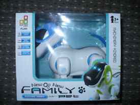 i-ROBOT Robotic Pet Dog Puppy. Blue. New condition. Lights up, barks, plays music, waggles tail.