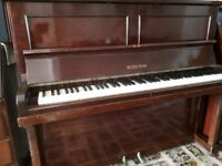 Piano still going strong and Looking for a new home.