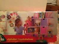 Pink early learning alphabet book shelves