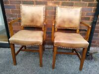 Elegant Leather-covered Captains Chairs