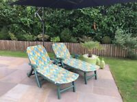 All weather fully reclinable green sun beds (with cushions)