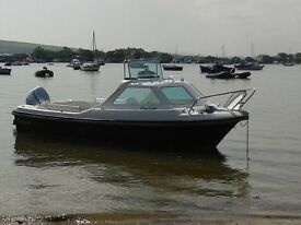 Kruger Beta 2. 17ft fishing boat. New 50 hp Honda o/b. Trailer. Seaworthy boat. Nice condition.