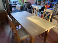 Very solid dining table and 4 chairs