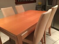 Cherry wood table and 4 chairs.