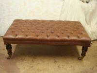 Traditional stool is upholstered in genuine leather