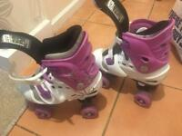 In Very good condition - Osprey Adjustable Girls Quad Roller Skates -