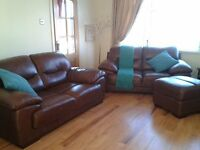 2 two-seatter dark brown leather sofas and storage footstool