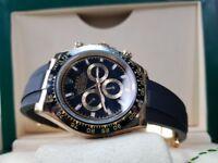 New boxed with papers set rubber bracelet gold case black face black bezel Rolex daytona with auto