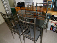 glass dining table chrome frame and legs and 4 chairs grey seats