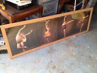 Dance picture with a wood frame.