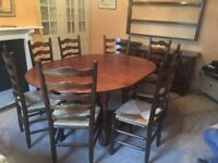 Hand made solid oak extendable dining room table and chairs x 8. Immaculate condition.