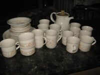 Coffee pot , cups, mugs and odd plates, bowls