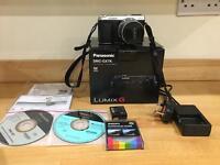 Panasonic LUMIX GX7 with 14-42mm lens and Panasonic leather case