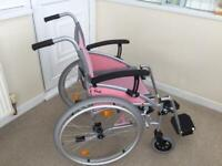 Wheel chair with adjusting arm rests .
