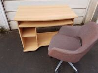 Computer desk with swivel chair