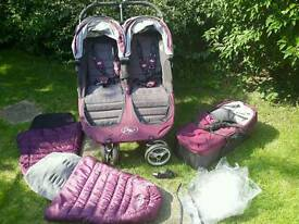 Baby Jogger City Mini Double with carrycot, rain cover and two footmuffs.