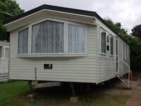 A lovely, privately owned gold 2 bed,6 berth, d/g,c/h caravan available for rent in Brixham
