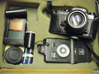 Chinon CE-4 35mm camera with accessories in brown case