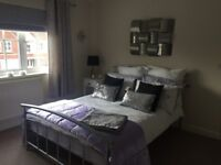 Next double bedding with matching curtains in liliac with bedcover and Roman blind.