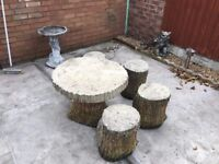 Stone tree trunk seats and table. (collection only)